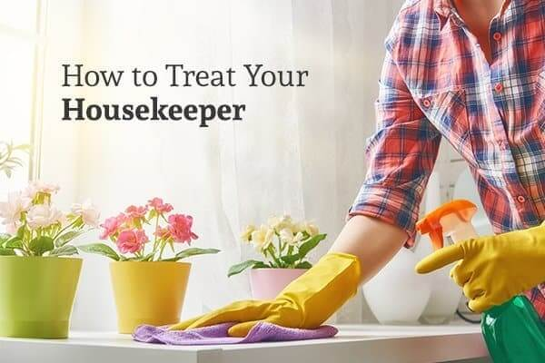 """A woman cleans a white table with flower pots on it under the words """"How to Treat Your Housekeeper"""""""