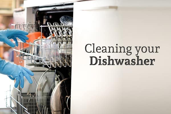 """A person wearing gloves reaches into a dishwasher full of dishes beside the words """"Cleaning your Dishwasher"""""""