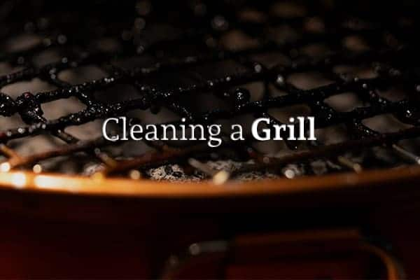 """A close up of the edge of a grill beneath the words """"Cleaning a Grill"""""""